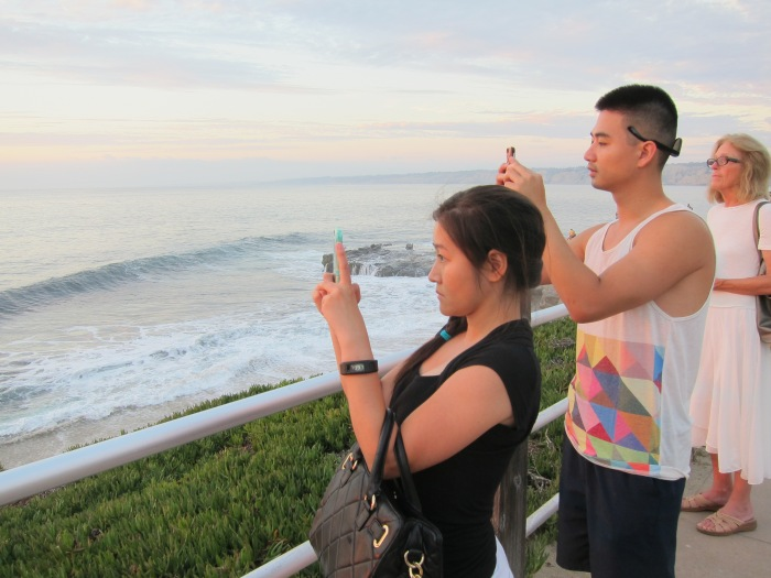 Taking pictures of people taking pictures of sunsets.