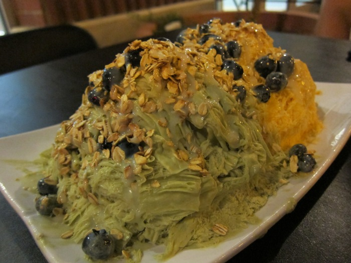 Dessert at Snow Station! Green tea and Thai tea snow shaved ice with blueberries and granola on top. Hmmmm hmmm yummy!